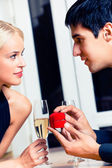 Happy amorous couple and a special man proposal in restaurant — Stock Photo