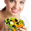 Portrait of happy smiling woman with vegetarian vegetable salad, — Stock Photo