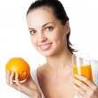 Portrait of happy smiling young woman with orange and glass of orange juice — Stock Photo