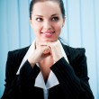 Closeup of thinking or dreaming businesswoman at office — Stock Photo #6770388