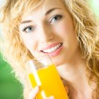 Young woman with orange juice at home - Stock Photo