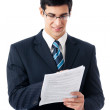 Businessman showing document or contract, on white — Stock Photo #6830871