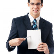 Businessman showing signboard with copyspase, on white — Stock Photo