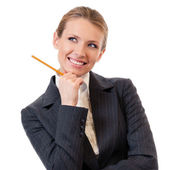 Happy thinking business woman with pencil, isolated — Stock Photo