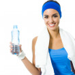 Woman in fitness wear with water, isolated — Stock Photo