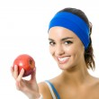 Woman in fitness wear with apple, isolated — Stock Photo