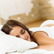 Woman on bed with greeting valentines card — Stock Photo