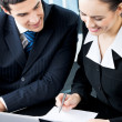 Two businesspeople signing document at office — Stock Photo #7023609