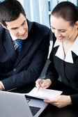 Two businesspeople signing document at office — Stock Photo