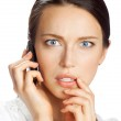 Puzzled businesswoman with cellphone, isolated on white — Stock Photo