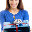Young happy smiling woman with gift, isolated — Stock Photo