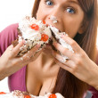 Stock Photo: Young hungry gluttonous womeating pie, isolated