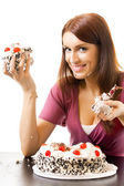 Young hungry gluttonous woman eating pie, isolated — Stock Photo