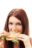 Hungry gluttonous woman eating sandwich with cheese, isolated — Stock Photo