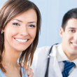 Stock Photo: Smiling patient and doctor at office
