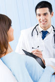 Doctor and patient at office — Stock Photo