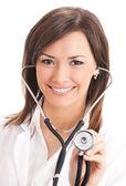 Doctor sonriente con estetoscopio, sobre blanco — Foto de Stock