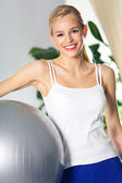 Woman with fit ball, at home — Stock Photo
