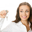 Woman or real estate agent showing keys, over white — Stock Photo