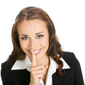 Businesswoman keeping finger on lips, isolated — Stock Photo