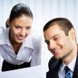 Two businesspeople working with document at office — Stock Photo