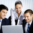 Businesspeople working with laptop at office — Stock Photo #7397784