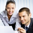 Two businesspeople working with document at office — Foto de Stock