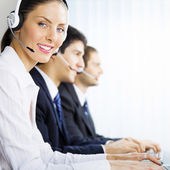 Three support phone operators at workplace — 图库照片