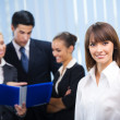 Portrait of happy smiling businesswoman and colleagues on backgr — Stock Photo #7510935