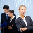 Portrait of happy smiling businesswoman and colleagues at office — Stock Photo