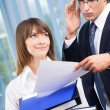 Two businesspeople working with documents at office — Stock Photo