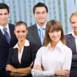 Stock Photo: Portrait of cheerful successful business team at office