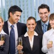 Happy business team celebrating with champagne at office — Stock Photo