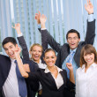 Foto Stock: Happy successful gesturing business team at office