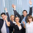 Happy successful gesturing business team at office — Photo