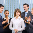 Successful happy businesswoman and businessteam at office — Stock Photo #7511287