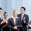 Successful happy businesswoman and businessteam at office - Stock Photo