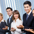 Happy businesspeople applauding at office — Stock Photo