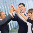 Happy successful gesturing business team at office — Stock Photo #7511320
