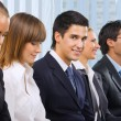 Portrait of businessman at conference. Focus on man looking at c — Stock Photo