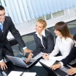 Stock Photo: Businesspeople at business meeting, seminar or conference