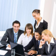 Stock Photo: Successful business team working together at office