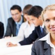 Businesswoman and colleagues on background, at office — Stock Photo