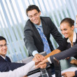 Happy successful gesturing business team at office — Stock Photo #7511711