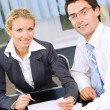 Two businesspeople working together at office — Stock Photo