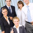 Portrait of cheerful successful business team at office — Stock Photo