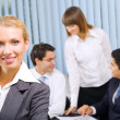 Portrait of successful businesswoman and business team at office — Stok fotoğraf