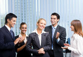 Successful happy businesswoman and businessteam at office — Stock Photo