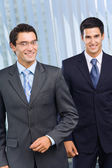 Two happy successful businessmen at office — Stock Photo