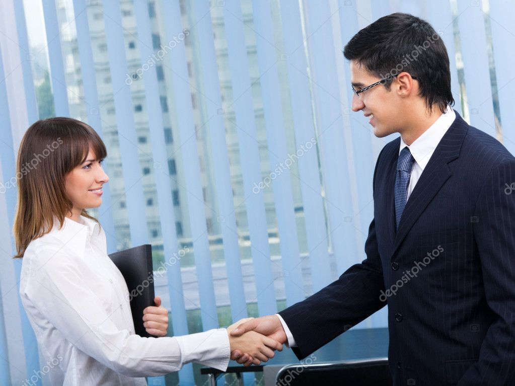 Two happy businesspeople, or businessman and client, handshaking at office — Stock Photo #7511016